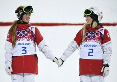 Second-placed Chloe Dufour-Lapointe (L) of Canada and her sister, first-placed Justine Dufour-Lapointe (R), hold hands during the flower cer...