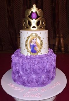 I made this 2 tier rosette repunzel cake with edible images and gumpaste gold painted crown
