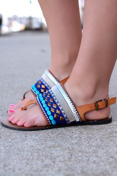 """Featuring an assorted gemstones embellished strap across vamp, T-Strap construction, stitching detail, lightly padded insole, and sling back with buckle closure. Heel Height: 0.5"""" Flat (approx) *All f"""