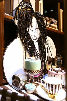Al Hirschfeld Spectacular! Installation at Henri Bendel, 5th Avenue, New York City. Al Hirschfeld Enters The 3rd Dimension: Sculpted Portrait Of Whoopi Goldberg. AlHirschfeld.com