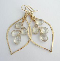 Cute earrings, love the leaf hoop and stones