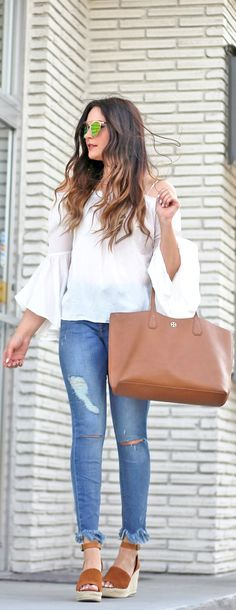 The perfect affordable spring outfit! | Fashion blogger Mash Elle styles Steve Madden Espadrilles with Express ripped cropped jeans, a Forever 21 white off the shoulder shirt, Free People aviators and Tory Burch perry tote.
