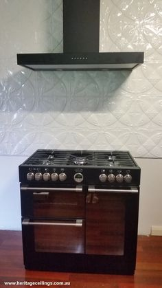 A pressed metal splashback using our Camellia panels.  The cabinetry is still to be installed.  Looking superb so far. See the pattern up close here: http://www.heritageceilings.com.au/tempat/camellia.php
