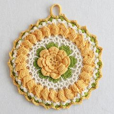 THIS IS A DOWNLOAD CROCHET PATTERN ONLY - NOT THE ACTUAL ITEM PB057 - Vintage Floral Potholders Crochet Pattern Potholders are so much fun to decorate with and keep in your kitchen! They can be so unique and add charm to any space. With this set of Vintage Floral Potholder, the