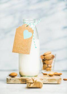 fresh vegan dairyfree almond milk in bottle with craft label