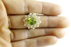 https://www.etsy.com/listing/450132252/fine-oval-cut-green-peridot-diamond-halo?ref=shop_home_active_75
