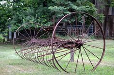 Old grass rake for raking a mowed field to bale for hay.  Taken south of St. Louis, MO
