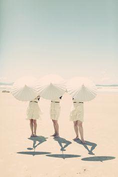 Three white umbrellas