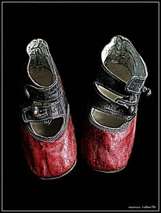 red and black baby shoes ... c. 1900