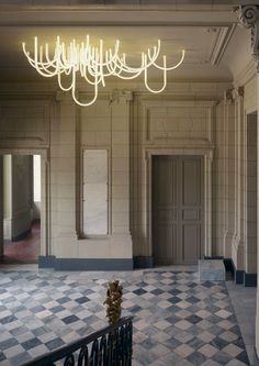 I love modern lights in old spaces.  If it can be installed within an old medallion?  Even better.