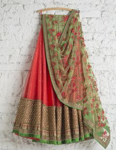 Lehengas by SwatiManish : Coral orange lehenga with floral green dupatta