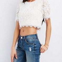 Lace Embroidered Top NWT Gorgeous White Top, So pretty and feminine. Great with a midi skirt or skinny jeans. Excellent Condition! Tags attached Charlotte Russe Tops Crop Tops