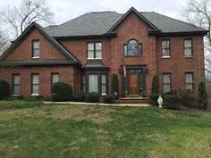 Image result for red brick house black trim