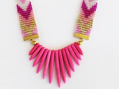 Now available on AHALife - Shh by Sadie handmade statement necklace. Hand beaded seed bead Aztec straps with bright pink spikes. Fashion / style / jewellery / jewelry / handmade / artisan / bespoke