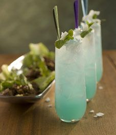 Blue Thai mojito 1/4 ounce blue Curaçao 1 1/2 ounces Bacardi Limon rum or Bacardi white rum 1 1/2 ounces Coco-Mint Syrup (recipe follows) 1 ounce fresh lime juice 2 ounces chilled soda water For garnishing Fresh mint and/or cilantro sprigs Shaved coconut (optional)