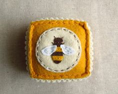 This embroidered honey bee felt pincushion by SeaPinks on Etsy is one of the gift ideas featured in the Stocking Stuffers section of Best Christmas Quilts 2012.