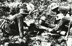 German troops trying to rescue a French soldier from sinking in a mud hole, 1916