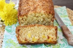 coconut-pineapple-bread  Yield: 1 loafCook Time: 60-65 minutes ingredients: 1 1/2 cups sweetened shredded coconut 1/2 cup unsalted butter, at room temperature 1 1/2 cups all-purpose flour 1/2 teaspoon baking soda 1/2 teaspoon salt 1 cup granulated sugar 3 large eggs 1 cup sour cream 2 cups fresh pineapple chunks