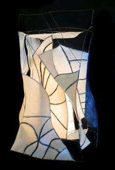 """Hut"" By HiiH Lights, 46"" x 24"" x 19"", Cotton-abaca paper, indigo pigment, beeswax and demar resin, wire, light fixture. www.artxchange.org"