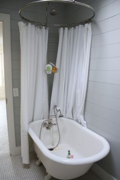 Cool looking clawfoot tub shower surround.