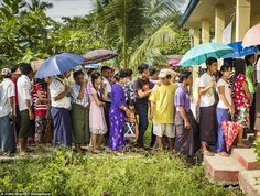 People stand in line to get into their polling station today in North Okkalapa, a township outside of central Yangon, Myanmar