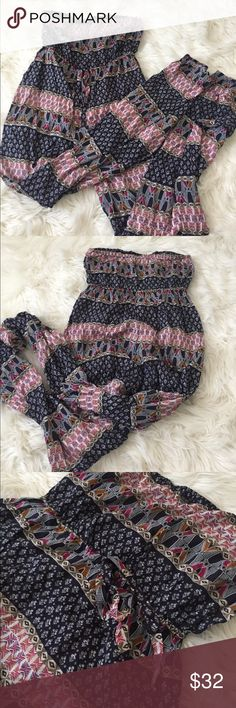 Urban outfitters sleeveless jumpsuit Lightweight jumpsuit perfect for summer. Aztec print, sleeveless with drawstring. Perfect condition. Fits true to size. Urban Outfitters Pants Jumpsuits & Rompers