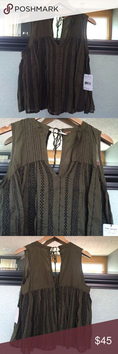 NWT Free People top Gorgeous olive green and black flowy fp top. Sleeveless with open tie back. It can be made smaller or larger. Reposhing but sad to see it go . Raw edge stitching and gorgeous stitched bottom. Shoulder to hem 23 inches Free People Tops