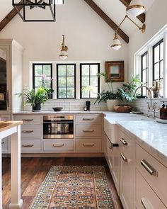 I love the warm and wonderful vibe of this gorgeous kitchen from the always-inspiring Jean Stoffer Design