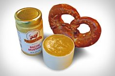 It might not contain any real bacon, but that's not going to stop us from devouring some Bacon Mustard. This gourmet sauce starts as a special recipe yellow mustard, which is mixed with ground brown mustard seeds, bacon flavored syrup,...