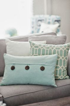 Love this for a couch!! Light grey with cream and robin egg blue green accents #livingroom #couch