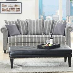 """Grey striped sofa with a solid wood frame and nailhead trim.  Product: SofaConstruction Material: Wood and polyesterColor: GreyFeatures: Nailhead trimDimensions: 31.5"""" H x 86"""" W x 37.5"""" DNote: Pillows not included"""
