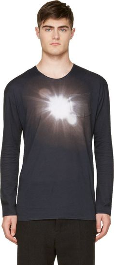Lightweight long sleeve t-shirt in black. Crewneck collar. Patch pocket at front. Graphic spot light print in white at front. Tonal stitching.