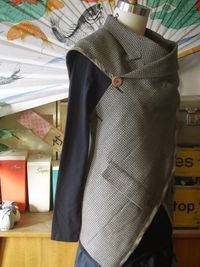 Whole page of recycled clothing, lots on using suits. Great ideas, no patterns