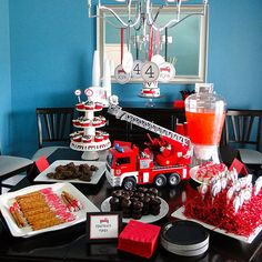 Real Mom: Emily of The Journey of Parenthood Real Party: Firetruck Party This adorable firetruck-theme food table showcased creative foods like chocolate-dipped pretzel matches, licorice fire hoses, and doughnut firetruck tires.