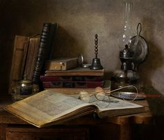 Oil lamp and books...