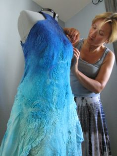 Nika Ivanoff, felter, putting finishing touches on felt dress. For more fiber art content, join the FiberArtNow.net tribe.