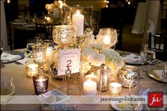 Pretty shorter arrangements with lots of mercury glass and candle light. Could mix these with taller arrangements on other tables to create a layered effect. Very romantic, classic feel.  candle_light_centerpeice_collection.jpg (1024×683)