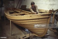 John Kerr who is building wooden boats the traditional way, in his workshop in Llandysul, Dyfed, Wales circa 1985.
