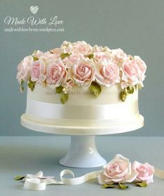 Beautiful pale rose topped occassion cake.