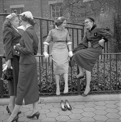 """""""School Girls"""" --  Four school girl dressed in finery gather on a sidewalk someplace in New York City in 1953. Photo by Frank Oscar Larson."""