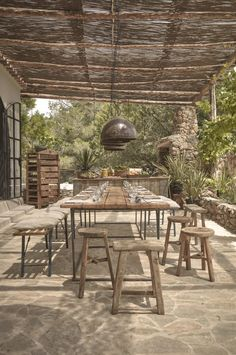 Outdoor dining at La Granja Ibiza, a Design Hotels retreat on a 16th century finca | Remodelista