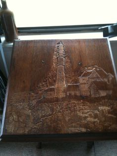 lighthouse on old table