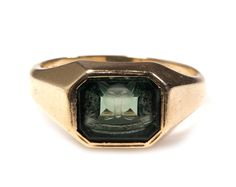 """Circa 1890-1910 Fox intaglio in synthetic emerald colored stone and 10k gold.    Engraving reads """"A G H 63""""."""