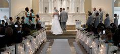 Ceremony decor -- like the lighting/fabric down the aisle.