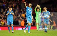 John O'Shea of Sunderland applauds the fans...