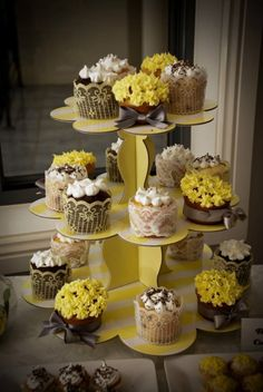 Three tier cake stands make for perfect cupcake displays.
