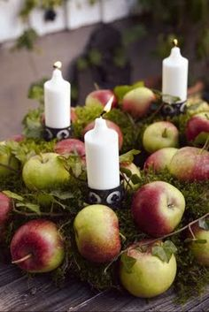 Apples and white candles centerpiece.