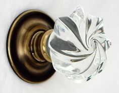 Clear whirl glass door knob on anitque brass rose by Merlin Glass