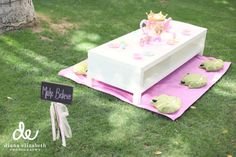 Even if your fairytale party is outside, use frog pillows as a seat.