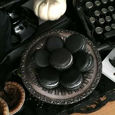 Black macarons at an Edgar Allan Poe Halloween  party! See more party planning ideas at CatchMyParty.com!